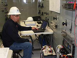 AET Test Technician testing protective relays